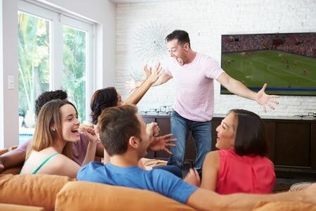 distributed audio and video friends celebrating game on tv
